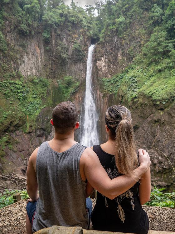 Travelers at Catarata Del Toro in Costa Rica.